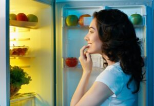 choosing food from refrigerator